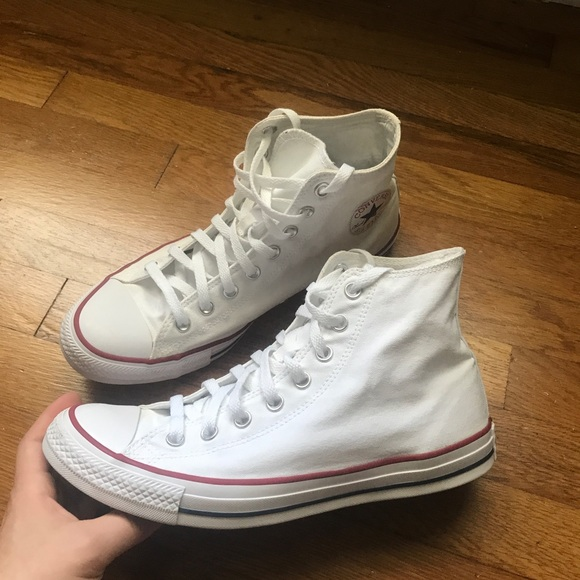 White Converse Chuck Taylors High Tops